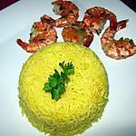 Crevettes flambées et riz safrané