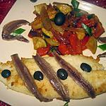 Filets de pangas aux légumes et anchois.