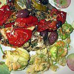 recette merlu a la provençale  du blog isabelle gastronome  et les boutons  de ^paquerettes au vinaigre  de  la cuisine  sur la table  et  beignets  de  fleurs de courgettes