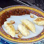 Quenelles à la semoule accompagnées de ses petits croutons à l'ail