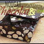 ** Du Nougat au chocolat Noir incrusté d' amandes et de pistaches grillées **