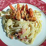recette Tagliatelles au saumon fumé décorées de brochettes de crevettes