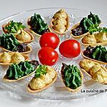 recette Amuse bouche garni de caviar de pois chiches au chèvre, de pesto aux épinards et confit à la truffe d'été