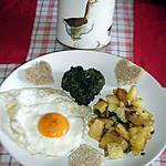 """recette """"OEUF AU PLAT""""avec pommes de terre dorées a la graisse d'oie, accompagné dun coeur d'épinard"""